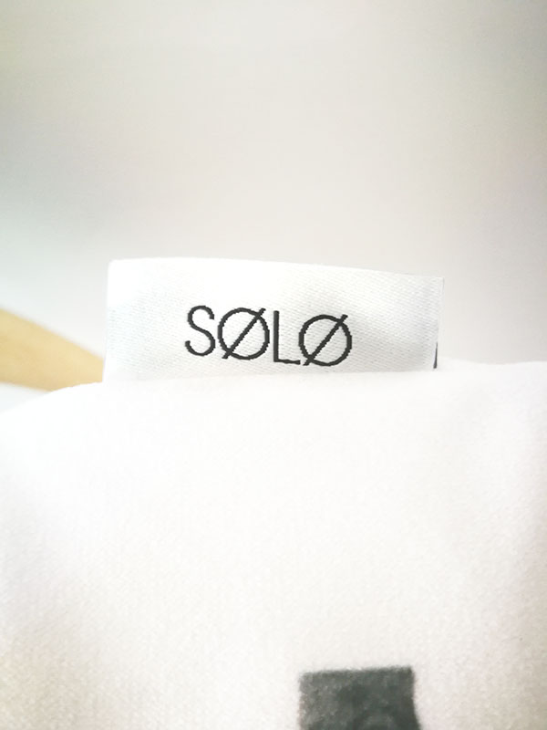 solo signature pillow tag